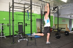 Rear-foot-elevated-splits-squats-with-overhead-reach