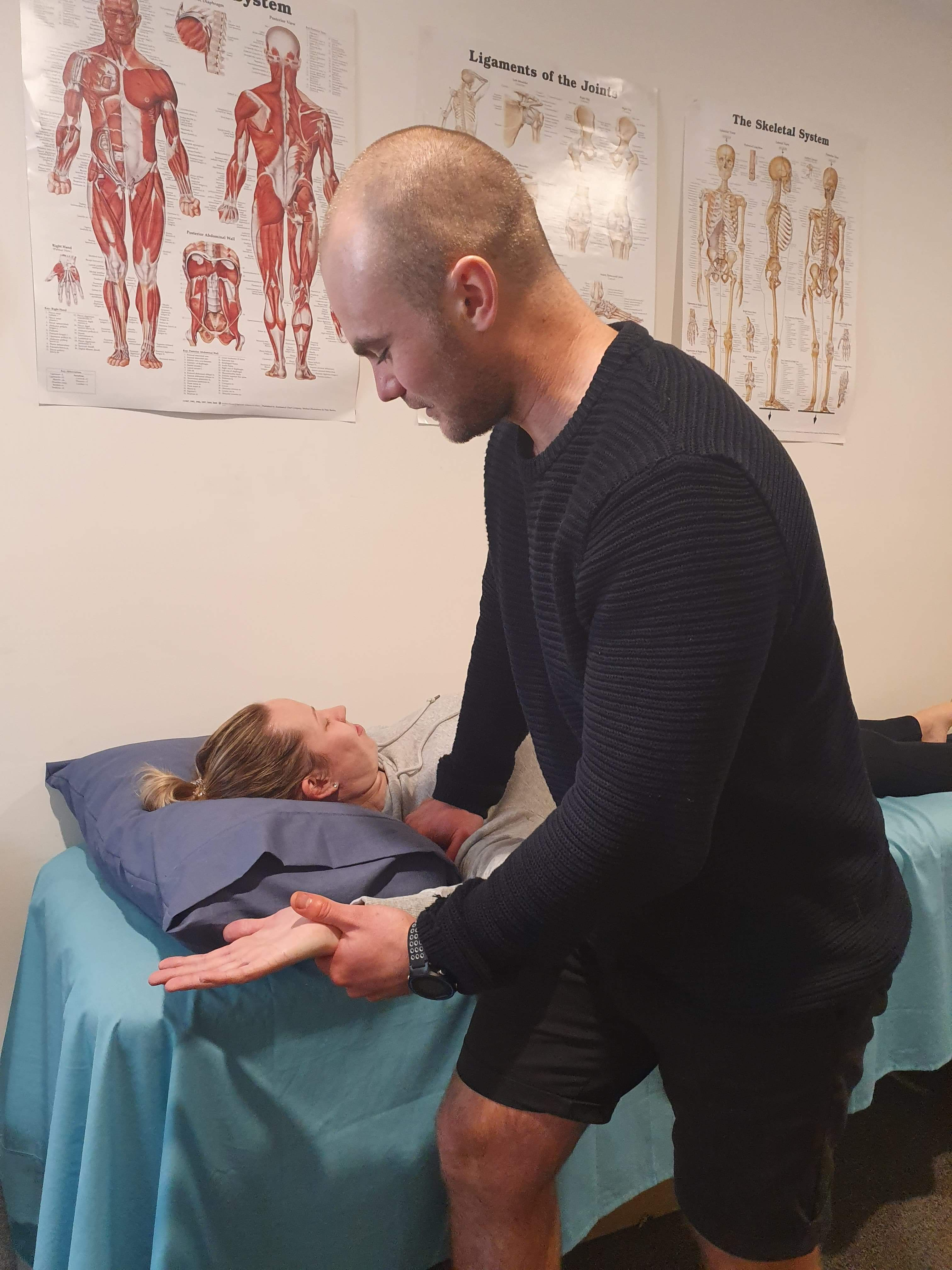 Patient being treated by physiotherapist trav in our treatment rooms at Moonee Valley Health and Fitness